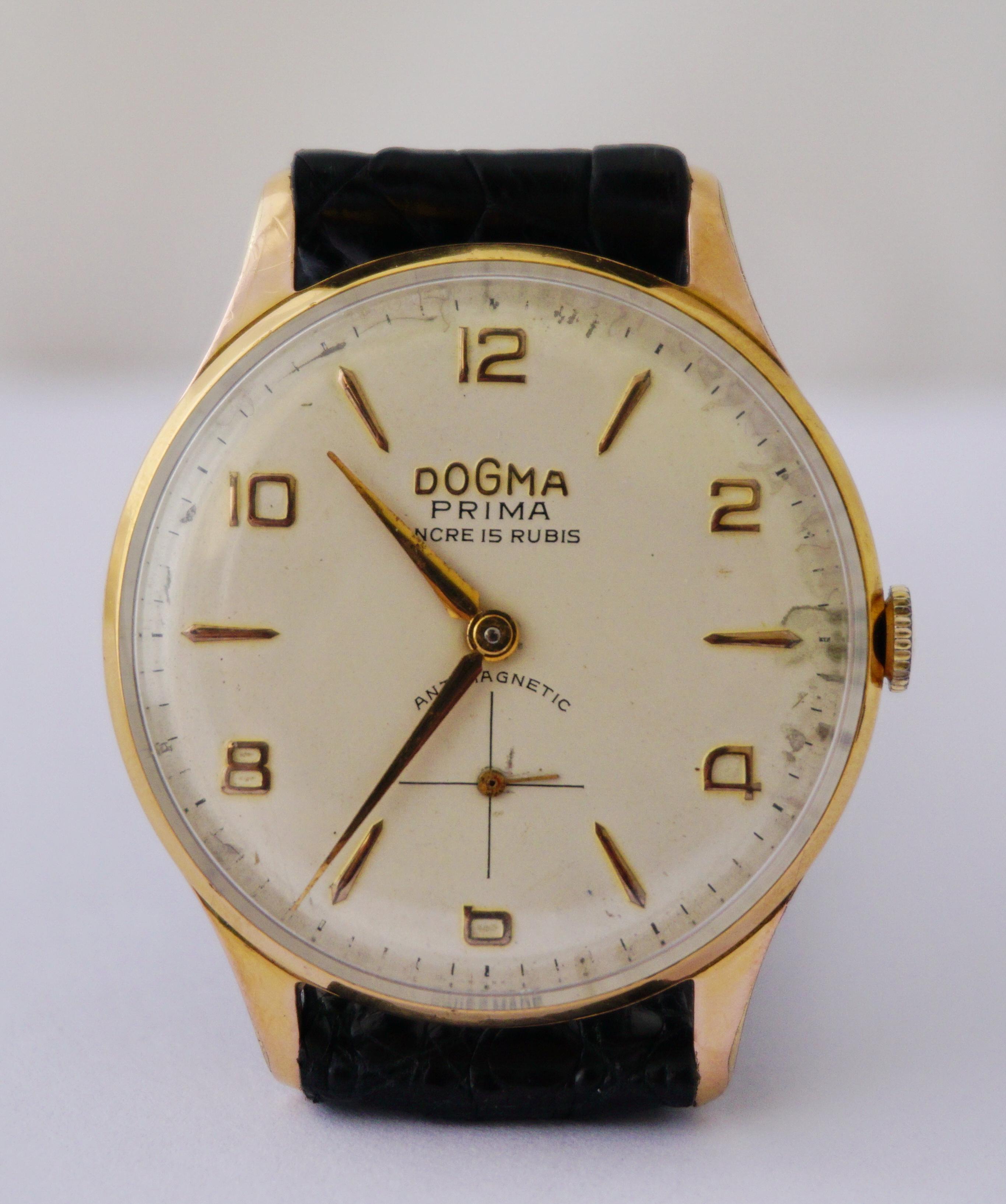 นาฬิกาเก่า DOGMA ไขลานสองเข็มครึ่ง