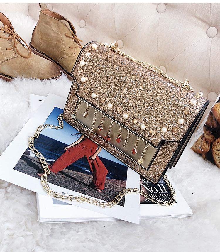 กระเป๋าแฟชั่น กริสเตอร์ วิ๊งสีทอง