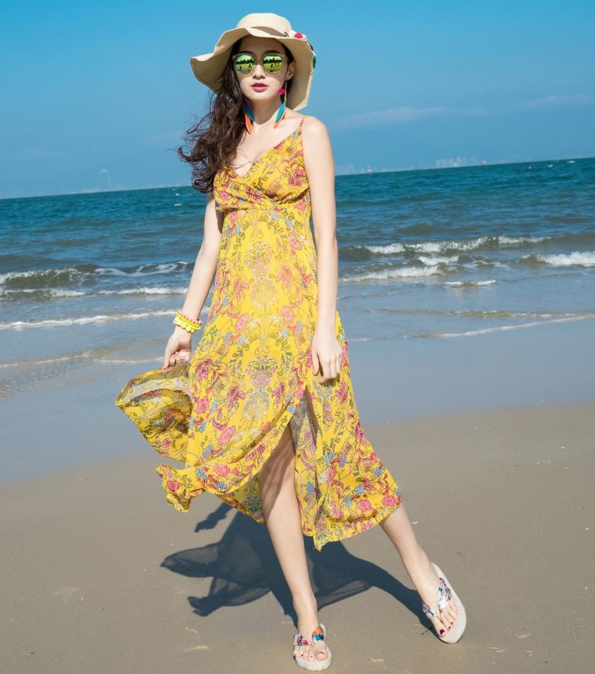 ชุดไปเที่ยวทะเล เดรสยาวสีเหลือง สายเดี่ยว ผ้าชีฟอง แฟชั่นริมทะเลสวยๆ