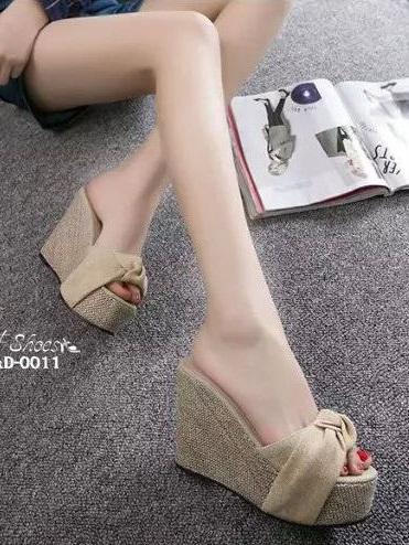 รองเท้าส้นเตารีดสีเหลือง ผ้าปอกระเจา ประดับโบว์ (สีเหลือง )