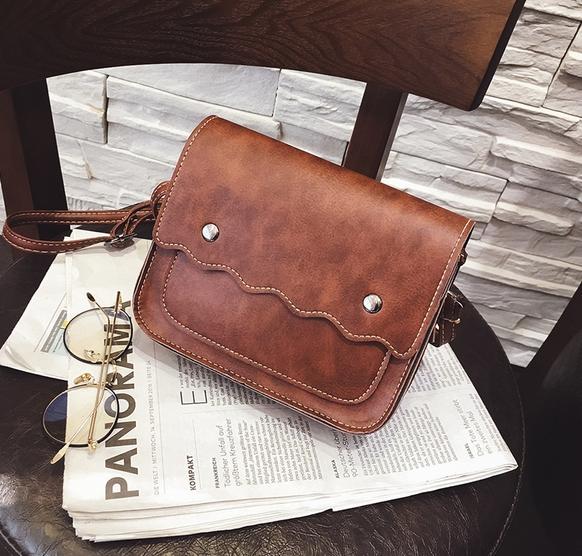 กระเป๋าถือ poppy bag (สี Deep Brown)