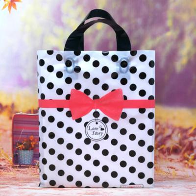 ถุงกระเป๋าขยายข้างสีขาวจุดดำคาดโบว์ 25x35x7 cm. 50 ชิ้น : P004694