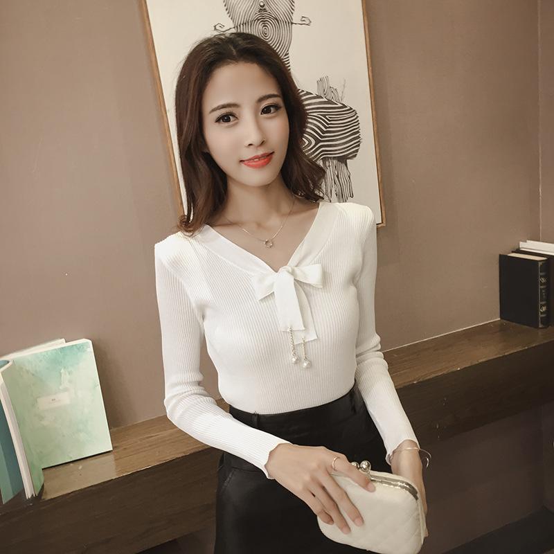 เสื้อแฟชั่นเกาหลี คอวีผูกโบว์ สีขาว
